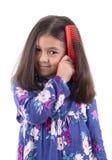有头发梳子的美丽的女孩 库存图片