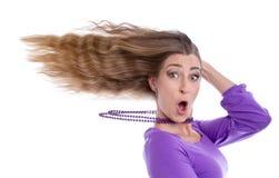 有头发的妇女在风 免版税库存图片