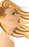 有头发的白肤金发的妇女在风 免版税库存照片