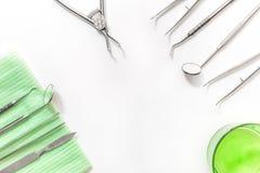 有仪器的牙医书桌在白色背景顶视图嘲笑 库存照片