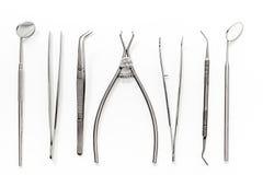 有仪器的牙医书桌在白色背景顶视图 免版税库存图片