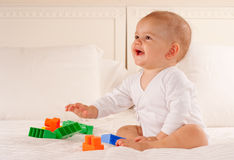 有婴孩的乐趣 库存图片