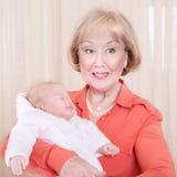 有婴孩的祖母 库存照片