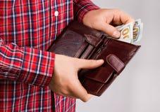 有货币的钱包 免版税库存图片