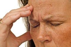 有紧张性头疼的妇女 免版税库存图片