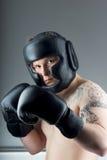 有黑手套的拳击手 库存图片