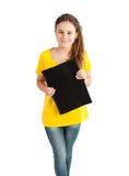 有黑文件夹的学校女孩 免版税图库摄影