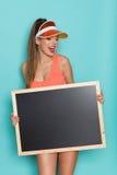 有黑板的呼喊的热的妇女 库存图片