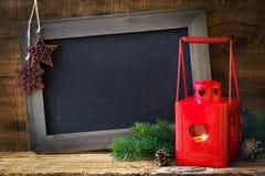 有黑板的圣诞节灯笼 库存照片