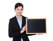 有黑板的女实业家举行 图库摄影