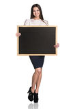 有黑板的妇女 库存照片