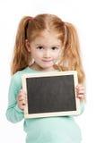 有黑板的小逗人喜爱的女孩 库存图片