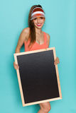 有黑板的微笑的性感的妇女 库存图片