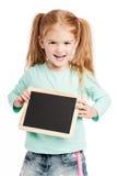 有黑板的笑的三岁小孩。 图库摄影