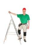 有活梯的体力工人 免版税图库摄影
