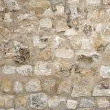 有水泥缝的,石制品框架背景花岗岩石墙 免版税库存照片