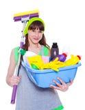 有洗涤剂和拖把的女孩 免版税库存照片