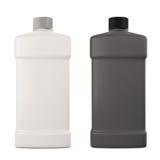 有洗涤剂的白色和黑瓶 库存照片