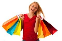 有购物袋消费者至上主义的ov美丽的少妇 库存图片
