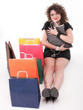 有购物袋的可爱的妇女 图库摄影