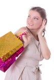 有购物袋的惊奇妇女 免版税库存图片