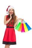 有购物袋的愉快的圣诞节女孩 图库摄影