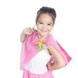 有购物袋的愉快的小女孩在白色 库存照片