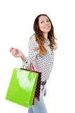 有购物袋的愉快的少妇 免版税库存图片