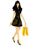 有购物袋的美丽的性感的女孩 免版税图库摄影