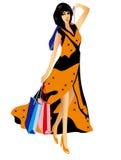 有购物袋的美丽的性感的妇女 免版税库存照片