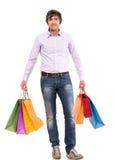 有购物袋的英俊的人 免版税图库摄影