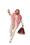 有购物袋的阿拉伯人在白色 免版税图库摄影