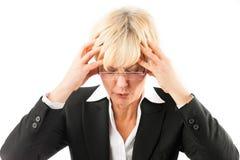 有头疼或烧坏的女商人 免版税图库摄影