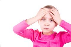 有头疼的不快乐的哀伤的小女孩 免版税库存图片