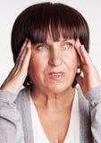 有头疼的哀伤的女性 免版税库存图片