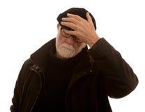 有头疼的老人 免版税库存照片