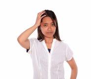 有头疼的迷人的亚洲少妇 库存照片