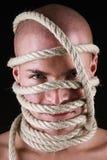 有绳索的人在他的头 库存图片