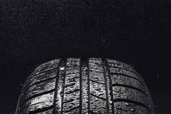 有水滴的夏天高效燃料的车胎 免版税图库摄影