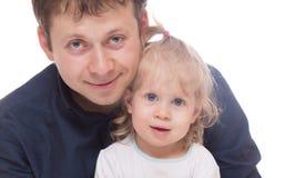 有他的女儿的微笑的爸爸被隔绝 库存照片