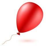 有绳索的明亮的红色气球 免版税库存照片