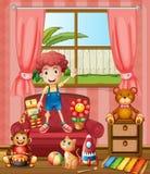 有他的猫和玩具的一个男孩 库存照片