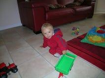 有他的玩具的一个男婴 图库摄影