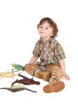 有他的玩具的微笑的小男孩 免版税库存图片