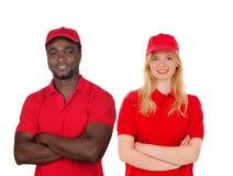 有他们的红色制服的工友 库存照片