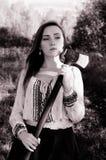 有轴的红色顶头女孩在森林里 免版税图库摄影