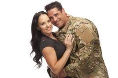 有他的妻子的战士反对白色 图库摄影
