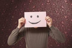 有滑稽面孔微笑的人 库存照片