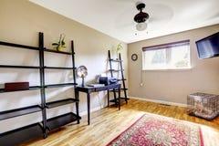 有黑简单的家具的办公室室 库存图片