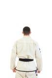 有黑腰带级选手的Kickbox战斗机佩带的和服在后面看法 免版税图库摄影